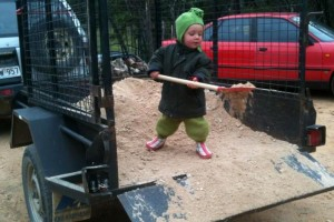 Emlyn helping to move gravel