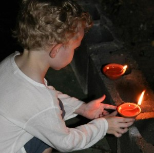 child placing candles