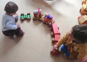 children play with toy train
