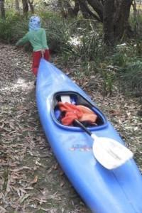 boy pulling canoe