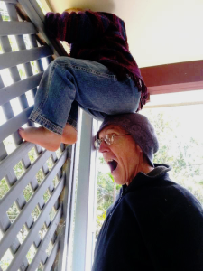 Boy climbing with father