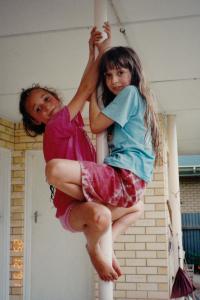 girls climbing a pole