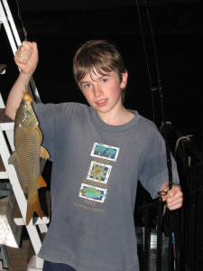 twelve year old boy with fish
