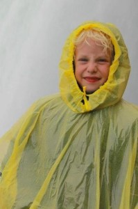 boy aged five in rain coat