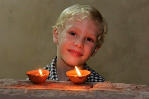 Boy age five with candles