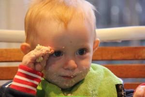 one year old eating porridge