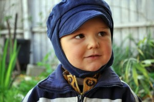 Boy in blue cap two & half