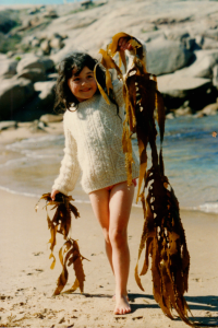 girl age seven with sea weed
